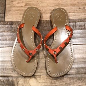 Orange Tory Burch flip flops